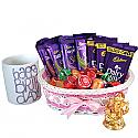Cadbury Basket With Birthday Special Mug And A Ganesh Statue