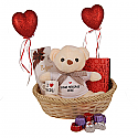 Teddy, Chocolates, Mini Cup And Hearts In Gift Basket