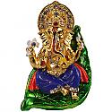 Metal Ganesh Ji Sitting On A Green Leaf
